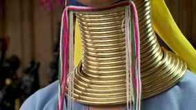 Layers of gold ring coiled in the neck of a Kayan