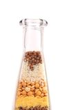 Layers of grains arranged in a bottle. Royalty Free Stock Photo