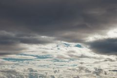 Layers of grey and white cloudes over blue sky royalty free stock image