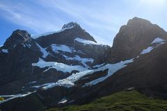 Hanging Glaciers nestled in a valley below the peaks of the mountains alongside the W walk trail in Torres Del Paine National Park. Layers of hanging Glaciers stock image