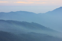 Layers of mountain covered with mist Stock Photo