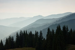 Layers of mountain and haze in the valleys. Stock Photography