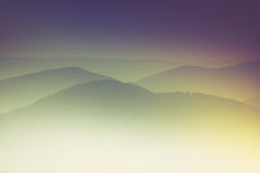 Layers of mountain and haze in the valleys. Stock Photo
