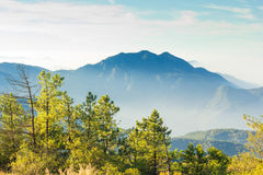 Layers of mountain among the mist and sun light Royalty Free Stock Image