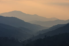 The layers of mountains at the dawn time Royalty Free Stock Photo