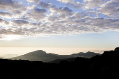 Layers of mountains and fog at sunrise Royalty Free Stock Photography