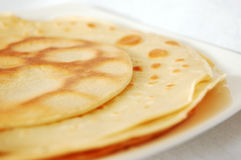 Layers of pancakes. Several pancakes on a white plate Stock Image
