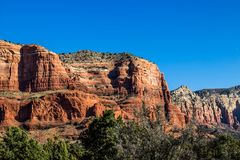 Layers In Red Rock Mountains Against Blue Sky Background Stock Photography