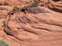 Layers on a red sandstone cliff Royalty Free Stock Image