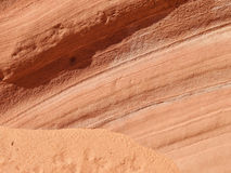 Layers on a red sandstone cliff Stock Image