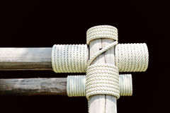 Layers of rope tied around a wooden log Stock Images