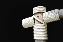 Layers of rope tied around a wooden log Royalty Free Stock Photo