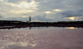 Layers of salt. Salines at dawn and old mill Stock Image
