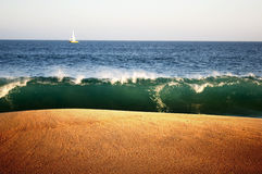 Layers of sky, water, wave, and sand. Royalty Free Stock Photo