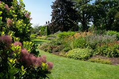 Layers, textures and a variety of colours in the planting scheme at Bressingham Gardens, Norfolk UK