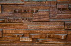 Layers of wood built up the design wall pattern in dark brown color. A Layers of wood built up the design wall pattern in dark brown color stock image