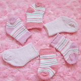 Layette for newborn baby girl Stock Image