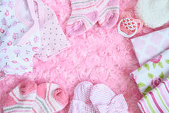 Layette for newborn baby girl Stock Images