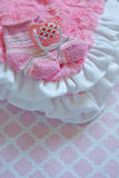 Layette for newborn baby girl Royalty Free Stock Photography