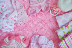 Layette for newborn baby girl royalty free stock photos