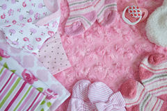 Layette for newborn baby girl royalty free stock images
