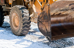 Laying Asphalt. A bulldozer in the process of laying asphalt Stock Photography