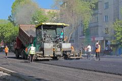 Laying asphalt on the pavement. stock images