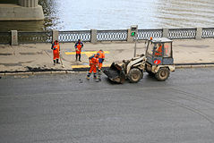 Laying asphalt pavement on the road in Moscow Stock Photos