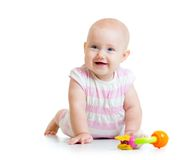 Laying baby girl using teether Stock Photo