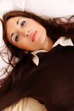 Laying on the Bed. A young woman laying on the bed Royalty Free Stock Photo