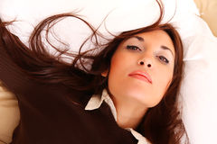 Laying on the Bed. A young woman laying on the bed Royalty Free Stock Photos