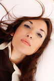Laying on the Bed. A young woman laying on the bed Royalty Free Stock Photography