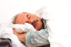 Laying in bed stock photography