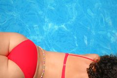 Laying in bikini girl from back near pool Stock Image