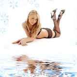 Laying blonde in black lingerie Royalty Free Stock Image