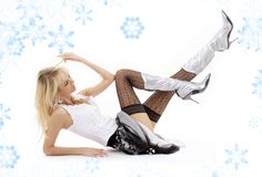 Laying blonde in silver boots Royalty Free Stock Photo