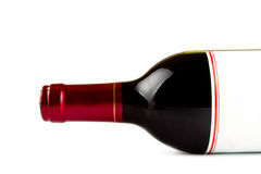 Laying bottle of red wine closeup Stock Photos