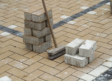 Laying brick flooring Stock Images
