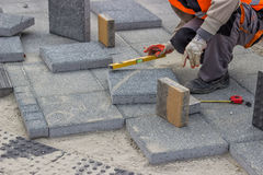 Laying brick pavers Stock Image