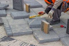 Laying brick pavers Stock Image