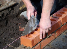 Laying bricks Stock Photos