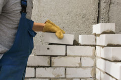 Laying bricks. Tools and supplies for the construction of walls made of bricks Royalty Free Stock Photos