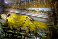 The Laying Buddha stutue in the Image House at Wewurukannala Vihara at Dickwella in Sri Lanka. The giant Laying Buddha stutue in the Image House at Stock Image