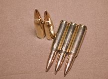 The laying cartriges 308 Winchester caliber with full metal jacket bullets steel case Stock Image