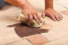 Laying ceramic floor tiles - testing the color of joint Stock Photo