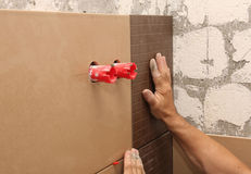Laying ceramic tile on wall Royalty Free Stock Images