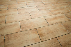 Laying ceramic tiles on the floor. selected focus. background Royalty Free Stock Photography