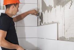 Laying ceramic tiles Stock Photography