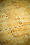 Laying ceramic tiles on a special cement grout. Selective focus. Stock Photo