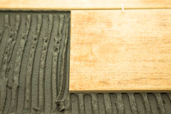 Laying ceramic tiles on a special cement grout. Selective focus. Royalty Free Stock Images